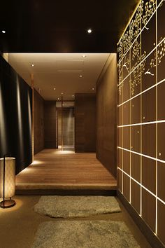 Wall Panels of carved cedar at entry to Wadakura Japanese Restaurant in the Palace Hotel, Tokyo