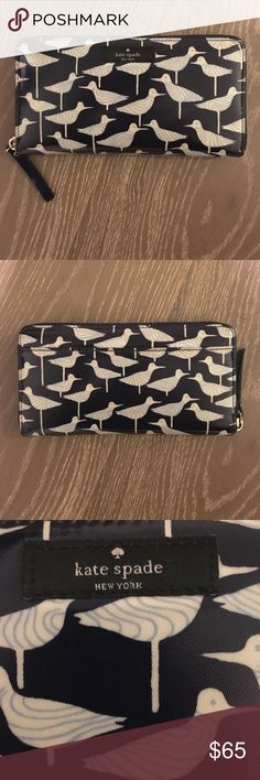 Kate Spade Neda Daycation Sandpiper Wallet Printed coated poplin and 14-karat light gold plated hardware.  Zip-around continental wallet, 12 credit card slots, 3 bifolds, zipper coin pocket and exterior slide pocket. Slight damage on underside of the pull tag (see pictures). Priced accordingly. kate spade Bags Wallets