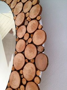 wood slices mirror - paint the backing disk your wall color so it fades away (or the color of the bark on the discs!)