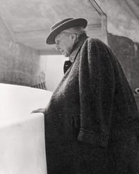 Frank Lloyd Wright overlooking the ramps during the construction of the Solomon R. Guggenheim Museum, ca. 1959, by William H. Short,