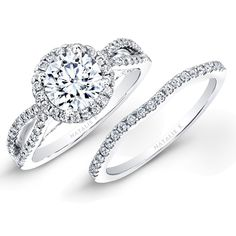 Two rows of 18k white gold covered in round white diamonds lead up to a center mounting surrounded by a halo of round white diamonds in the diamond engagement ring of this bridal set. The wedding band is also covered in round white diamonds   This ring is available in our store!