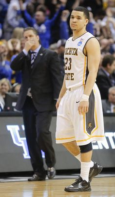 Wichita State's Fred VanVleet stands in disbelief while Kentucky coach John Calipari shows some disbelief of his own after The Shockers lost 78-76 in the third round of the NCAA Tournament, ending their historic season at 35-1.  Read more here: http://www.kansas.com/2014/03/23/3364006/shockers-amazing-season-comes.html#storylink=cpy