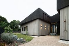 MRTN Architects's House Under Eave has a shifting scale - from the street it…