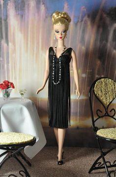 Betty Draper black dress with fringe.