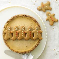 bhgfood:  Gingerbread Cheesecake: Spread holiday cheer with a rich cheesecake that's filled with comforting winter flavors and topped with adorable Gingerbread Cutouts.