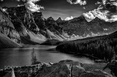 Moraine Lake - Pinned by Mak Khalaf Probably one of the most photographed places in the world and for good reason. It is incredibly beautiful! Landscapes ABAlbertaBanff National ParkBlack and whiteCanadaCanadian RockiesMoraine Lakecloudslakelandscapemonochromemountainsskysummerten peakstraveltreeswater by brandongodfrey