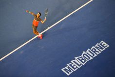 Rafael Nadal of Spain serves in his men's final match against Stanislas Wawrinka of Switzerland during day 14 of the 2014 Australian Open at...