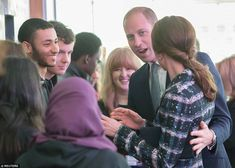 William places a protective hand on his wife's back as they chat with guests and the National Football Museum