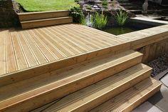 Grooved timber deck boards used on steps and raised deck (Arbordeck) Koi Pond Design, Deck Design, Garden Design, Sunken Hot Tub, Deck Cost, Propane Patio Heater, Timber Deck, Cool Deck, Ponds Backyard