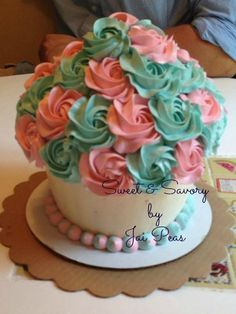 Obviously prettier colors, but the flowers are cupcakes and the base is a cake too,