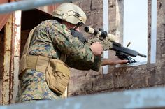 A Marine sniper shoots his target during the United States Army Special Operations Command Sniper Competition at Fort Bragg, Dec. 5. This competition is usually held once a year and is open to Marines, Navy Seals, Army, U.S. law enforcement agencies and foreign military Special Forces.
