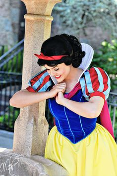 Snow White at the wishing well- I ALWAYS sing at the wishing well when I go to Disneyland~