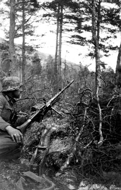 German Gebirgsjäger (light infantry alpine or mountain troops) of the Infantry Regiment, Mountain Division with an MG 34 machine gun sits in position in the forest of Norway's Junkerdal National Park during Germany's invasion of Norway, May German Soldiers Ww2, German Army, Luftwaffe, Mg34, Germany Ww2, Man Of War, Military Pictures, War Photography, World War One