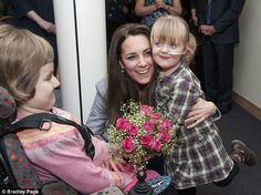 Cuddles with the Duchess: Kate met children with life-limiting conditions including Demi-Leigh Armstrong, aged five, who gave her a big hug  Read more: http://www.dailymail.co.uk/femail/article-2519394/Duchess-Cambridge-goes-solo-tea-party-childrens-hospice.html#ixzz2mjcDQTOa  Follow us: @MailOnline on Twitter | DailyMail on Facebook