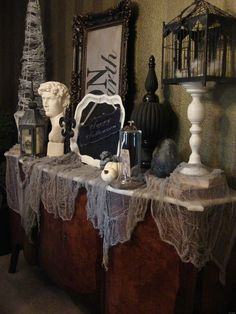 """INSPIRATION: """"use non-Halloween items; pull it all together with the creepy cloth, pumpkins and a skeleton"""""""