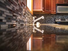 Decoration, In Demand Glass Tile Backsplash Pictures Grey Color And Dark Glossy Granite Countertops Also Stainless Mixer Taps Single Sink Pl...