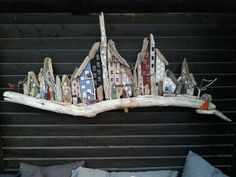 Stor drivtømmer by. Huges driftwood town/houses. Designed by EVAS .