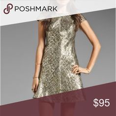 Shoshanna Metallic Jacquard Bethany Dress Shoshanna Byzantine Metallic Jacquard Bethany Dress is perfect for the holiday season. A line cut flatters almost all body types. Beautiful metallic gold color with textured rich fabric. V back detail and capped sleeve. Class Shoshanna brand. Worn only once for work holiday party (4 hours total). Brand new condition. Shoshanna Dresses Mini