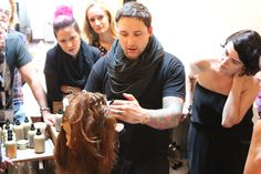 2014 Davines World Style Contest Finalist Chantal Girard looks in as Davines North America Master Session Ambassador Joseph DiMaggio demonstrates advanced blowdrying and cutting techniques to the Regional Artistic Team at new collection training, July 15, 2014.