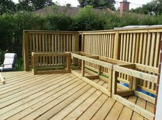 Building a wooden deck over a concrete one : Adding storage benches