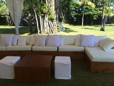 Our super long teak sofa with teak coffee tables & poufs at the fabulous Villa Atas Ombak. #Bali #weddings #events #furniture #hire #rental  #Revelrevelbali #BaliUltimate