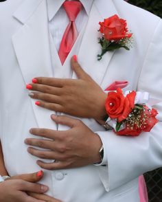 Love the Coral on White this Prom Couple has going on!