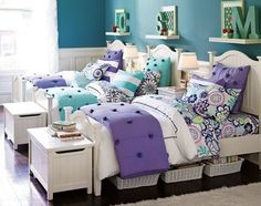 Girls shared bedroom with cute shelves. Purple and white, my favorite color combination...with floral patterns in throw pillows.