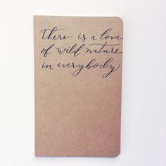 JOURNAL, notebook, guestbook, love of wild nature, handwritten quote, wedding, kraft, hand lettered, calligraphy, gift, present, travel, adventure, nature. Handwritten calligraphy quote on a kraft journal notebook with 25 sheets of blank white paper inside (50 pages) Journals are size 5x8. They have paper covers, they are not hardbound. Inside has 25 sheets of blank white paper (50 pages). Accessories not included-listing is for journal only. As each cover is handwritten, small variations...