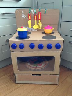""""" 16 Awesome DIY Cardboard Toys – March 2020 – Ducks 'n a Row """" Homemade DIY cardboard box stove wth oven for """" Cardboard Kitchen, Cardboard Box Crafts, Cardboard Playhouse, Cardboard Toys, Toilet Paper Roll Crafts, Cardboard Furniture, Cardboard Box Ideas For Kids, Toy Storage Solutions, Diy Toy Storage"