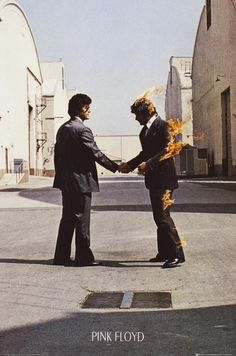 """A great poster of the enigmatic Hipgnosis album cover art from the Pink Floyd LP Wish You Were Here! Take some """"Time"""" to check out the rest of our amazing selection of Pink Floyd posters! Need Poster Mounts. Album Pink Floyd, Arte Pink Floyd, Pink Floyd Album Covers, Pink Floyd Poster, Pink Floyd Artwork, Storm Thorgerson, Arte Punk, Pub Vintage, Music Pics"""