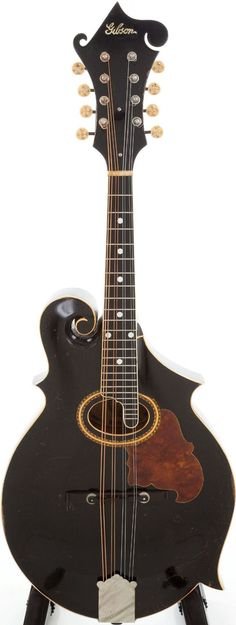 frettedchordophones: Gibson F 2 Mandolin in Black =Lardys Chordophone of the day - a year ago --- https://www.pinterest.com/lardyfatboy/