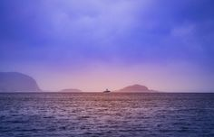 purple pink sky sunset sky clouds boat ocean sea water horizon nature