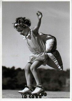 Little girl learning to roller skate in 1920