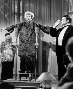 Orson Welles the magician performing with Lucille Ball.