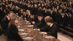 """Harry pouring one back in the dining hall: 