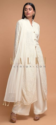 Buy Online from the link below. We ship worldwide (Free Shipping over US$100)  Click Anywhere to Tag Off White A Line Palazzo Suit In Georgette Adorned With Lucknowi Thread Embroidery Online - Kalki Fashion Off white A line suit in georgette adorned with lucknowi thread embroidery along with sequins all over.Designed with mandarin collar, front slit and full sleeves.