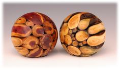 """Cedar and Yew.   These are roughly 4"""" diameter spheres made from the branches of trees with significant symbolic characteristics. These two are from Yew and Cedar, symbolizing Wisdom (Yew), Incorruptibility (Cedar), and Longevity (both). The branches are either trimming or storm-fall and allowed to cure in the woods for at least a full year.  They have felted bottoms and are sealed with a combination of oil finish and carnauba wax."""