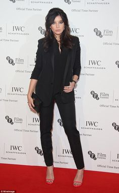 Standing out: Daisy Lowe decided to wear an all-black trouser suit rather than a design go...