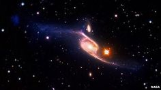 VLT/Galex image of NGC 6872 - New Discovery, LARGEST spiral galaxy found as a result of an intergalactic crash.