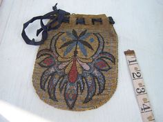 Hey, I found this really awesome Etsy listing at http://www.etsy.com/listing/88678587/antique-beaded-bag-purse-french-steel