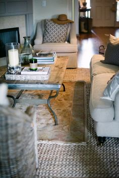 The large weave of the bottom layer creates a textural contrast with the small, dense pattern of the accent rug.
