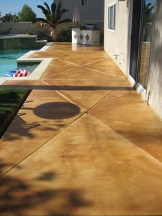 i like the look of the stained concrete around pool | building