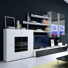 Aménagez tout votre salon avec ce magnifique ensemble télé DELTA I ! Ce meuble design est composé de 8 éléments apportant chacun du caractère et du style à l'ensemble. Tiroirs, placards, vitrines, étagères, l'indispensable du rangement est là ! Un grand meuble de rangement à quatre portes de 1mx1m accueillera tous vos jeux de société, votre vaisselle des grands jours,... L'ensemble est noir et blanc et les parties noires possèdent une finition laqué brillant.
