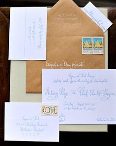 A blue calligraphed invitation is stuffed into a kraft-paper envelope for an organic feel.