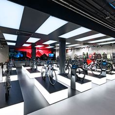 Rose Biketown Store by Blocher Blocher Partners at MONA Mall, Munich – Germany Retail Store Design, Retail Shop, Visual Merchandising, Pop Up, Retail Solutions, Bike Store, Bicycle Shop, Motorcycle Store, Exhibition Stand Design