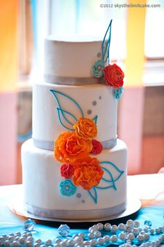 Modern wedding cake with this year's hot colors: Teal and Orange    http://www.skysthelimitcake.com/    Photography: http://www.lisacrates.com    Event Planning:  http://roshelevents.com/