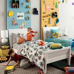Love the painted pegboard decoration from Land of Nod. Also the robot bedding. Pegboard Headboard, Clever Kids, White Bedding, Baby Bedding, Boy Room, Girls Bedroom, Boy Bedrooms, Shared Bedrooms, Bedroom Decor