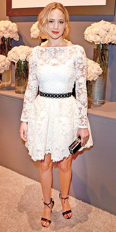 JENNIFER LAWRENCE In a delicate lace creation by the late Oscar de la Renta, Jennifer (who has had memorable red carpet moments in his pieces before) looks elegant at ELLE's Women in Hollywood celebration in Beverly Hills.