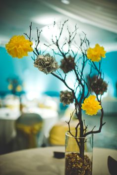centerpiece. you can DIY! #manzanita #greyandyellow #tissuepoms