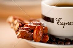 sweet almond and coffee - A close-up image of sweet almond confection and a dark coffee on the table